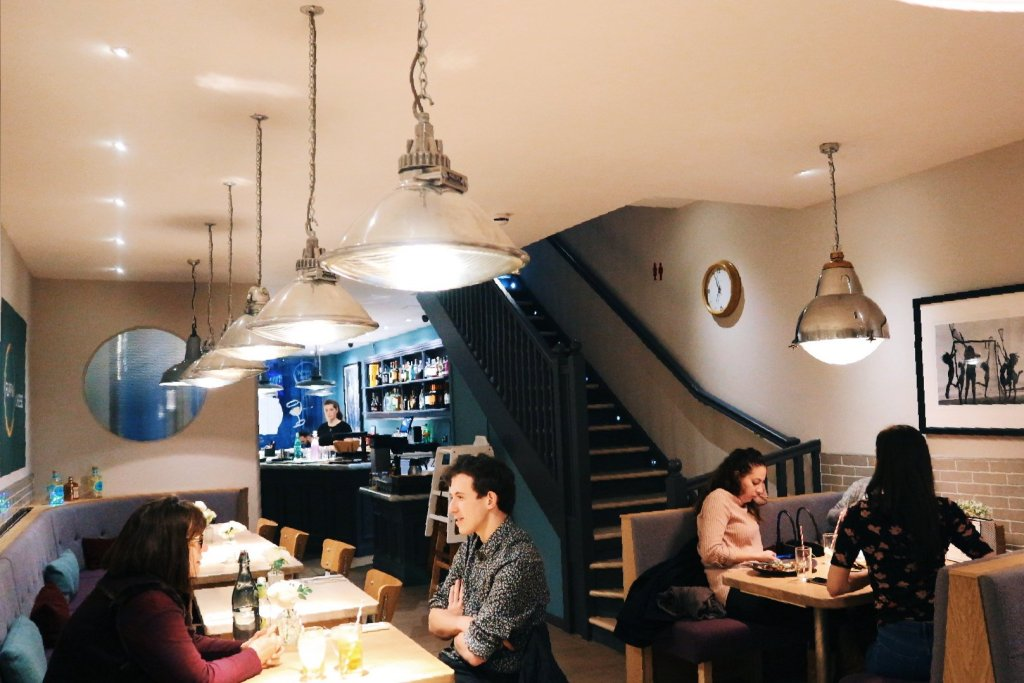 Flippin' Cheese restaurant interior and customers