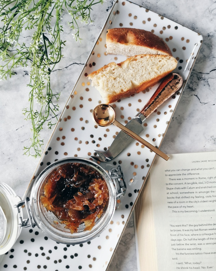 Slices of home made rosemary and sea salt focaccia with a jar of caramelised onion chutney