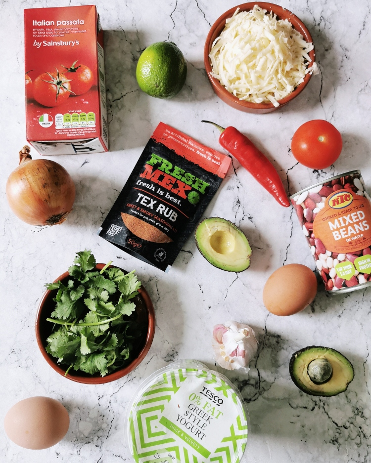 Flatlay of ingredients needed to make Huevos Rancheros using the Fresh Mex Sweet and Smokey Tex Rub